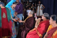 Divya Aravind receiving the gift from the elders