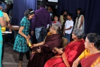 Poojitha receiving gift from elders