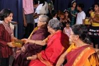Adithi receiving gift from elders