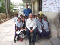 Members of the trust with students of the school