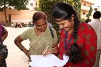 Volunteer doing a survey on medical insurance