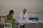 Dr. M Bhaskar Rao attending patients