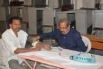 Dr. U N Achar attending patients